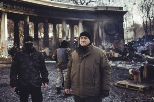 Dmitro Yarosh, the leader of Pravy Sektor, a coalition of ultra-nationalist groups in Ukraine, stands with some of his fighters at the scene of the worst clashes last month between the group's fighters and police in Kiev. Photo: TIME