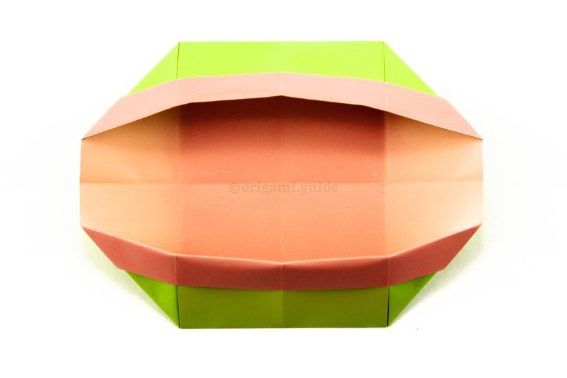 18. Open up the top and bottom sections, at the same time the left and right sections will rise upwards.