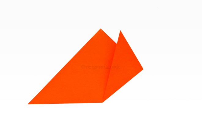 5. Take the right point and fold it upwards at an angle from the pinch mark you just made.