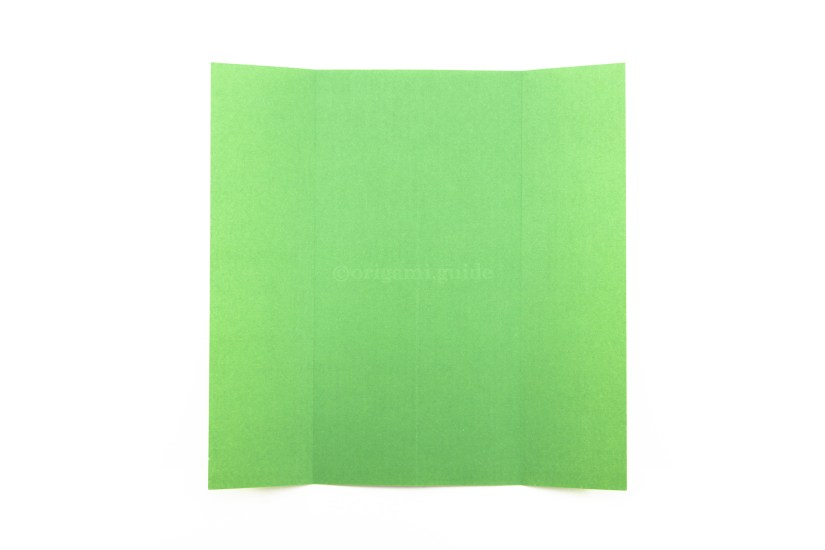 6. Unfold the paper completely.