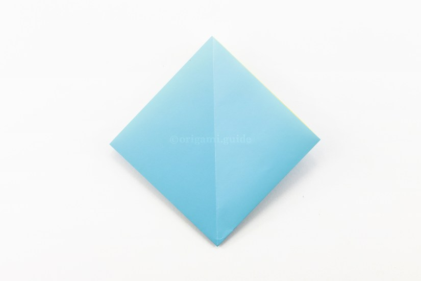 1. Start with an origami square base. The open end of the square should be at the top.