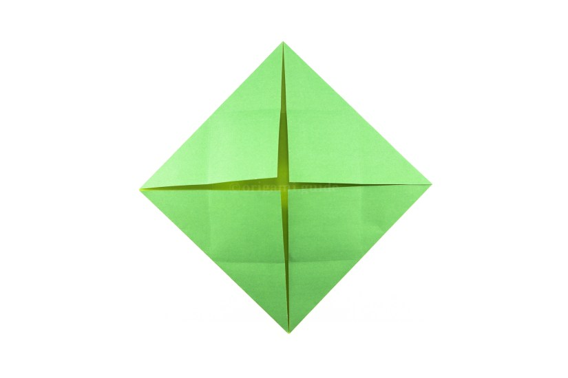 14. Fold the other three corners in to the center.