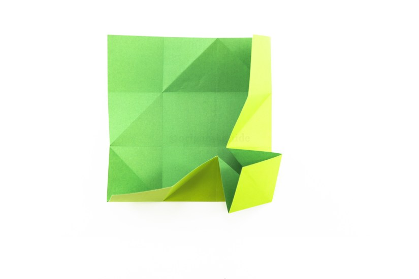 18. Fold the bottom and right sections inwards together, collapsing the bottom right corner forward.