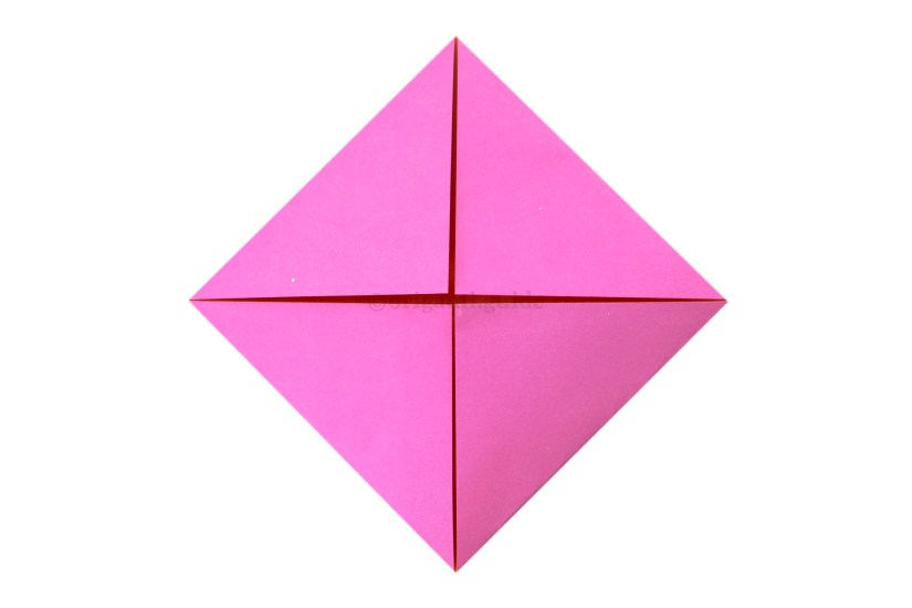 7. Fold the other three corners of the paper to the middle of the paper.
