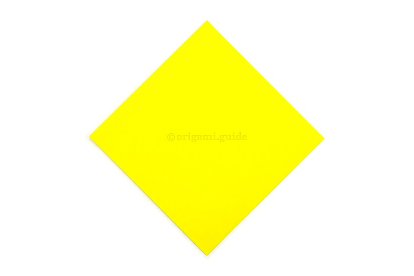 1. Start colour side up. If you are using sticky notes, have the sticky edge stuck down to the table on the diagonal top left edge.