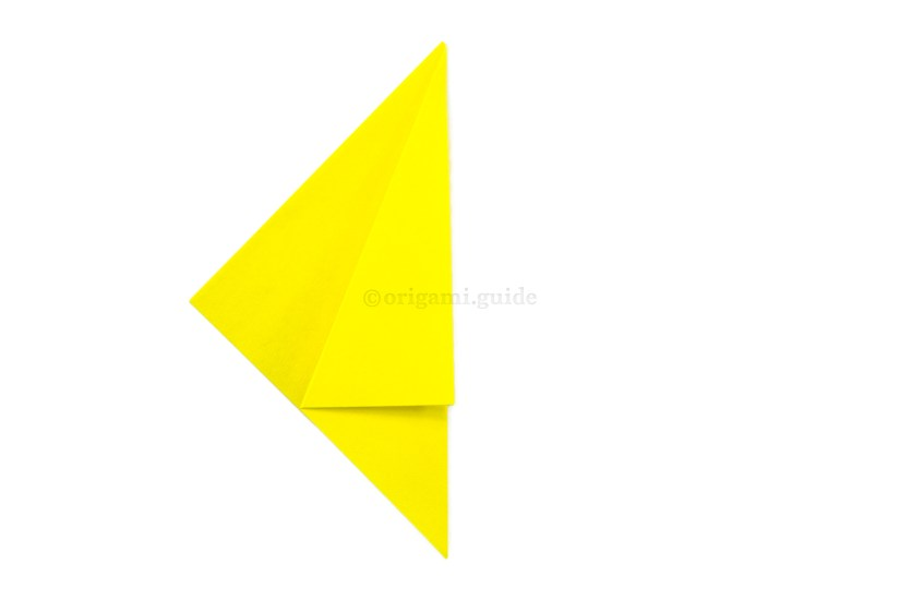3. Fold the point back over to the right, aligning the diagonal edge to the right edge.