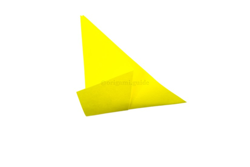 5. Fold the bottom point up to the top point, folding only the right section.