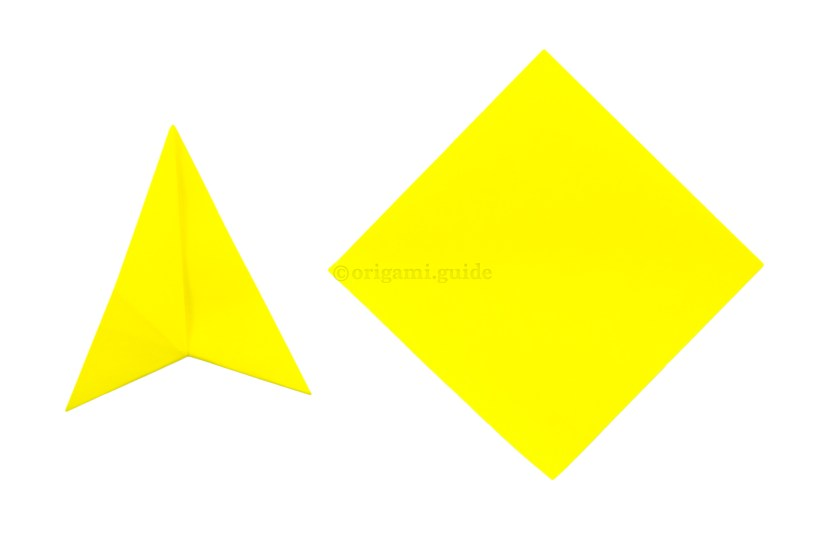 7. Take the second sheet of paper, white side up. If using sticky note, have the sticky edge stuck to the table, on the bottom left diagonal edge.