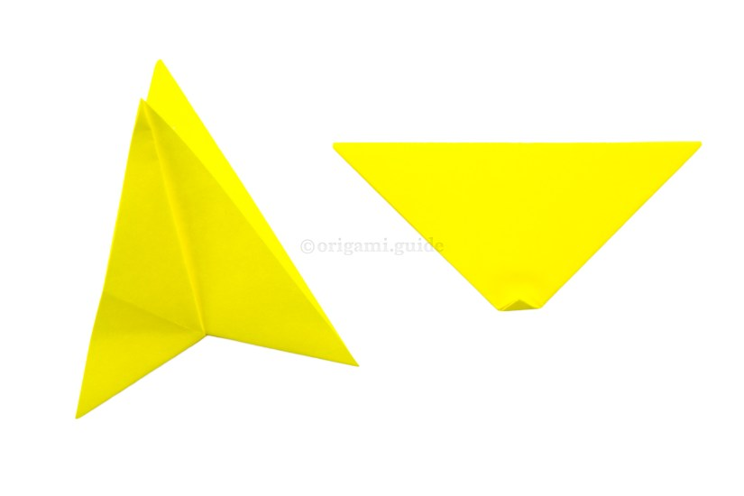 10. Rotate the triangle. You can fold the bottom point up a tiny bit, to make the star a more symmetrical shape. Open the first star shape.