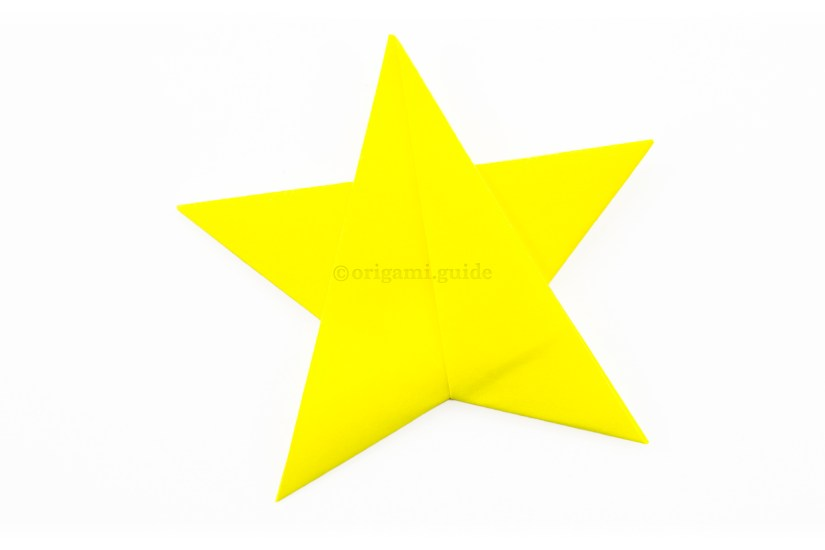 11. Insert the triangle between the two flaps and secure with tape, glue or string to hang the star up. If you used sticky notes, you won't need to, as it will be stuck by itself!