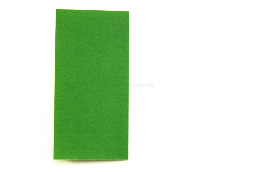 3. Fold your paper in half by taking the right edge over to the left edge.