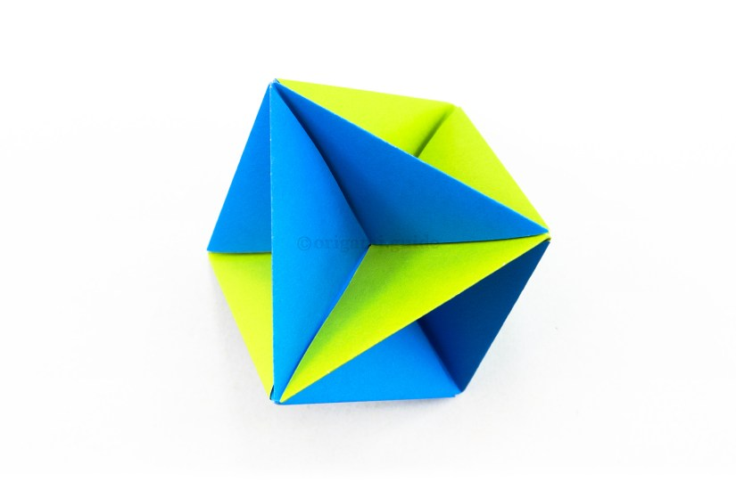 20. The modular origami spinning toy is complete! To make it spin, put two of the points in between the palms of your hands and blow it, the model will spin!