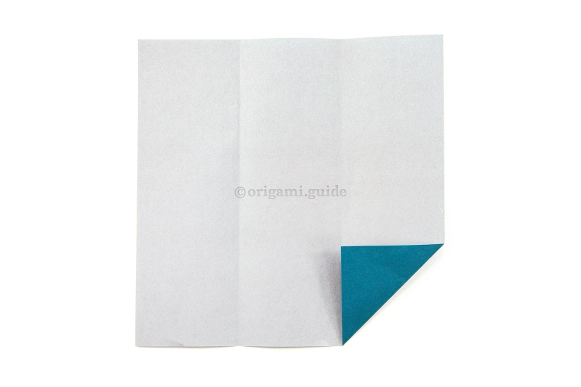 10. Next, fold the bottom right corner diagonally, aligning with the right vertical crease.