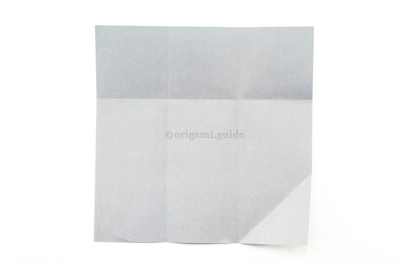 12. Unfold both the top and lower diagonal flap.