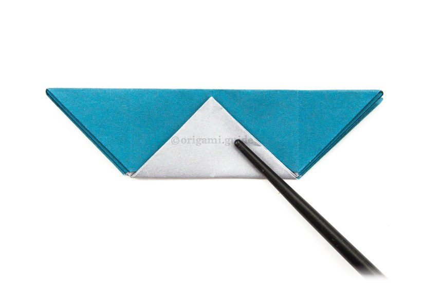 31. Fold the bottom point up to the top edge.