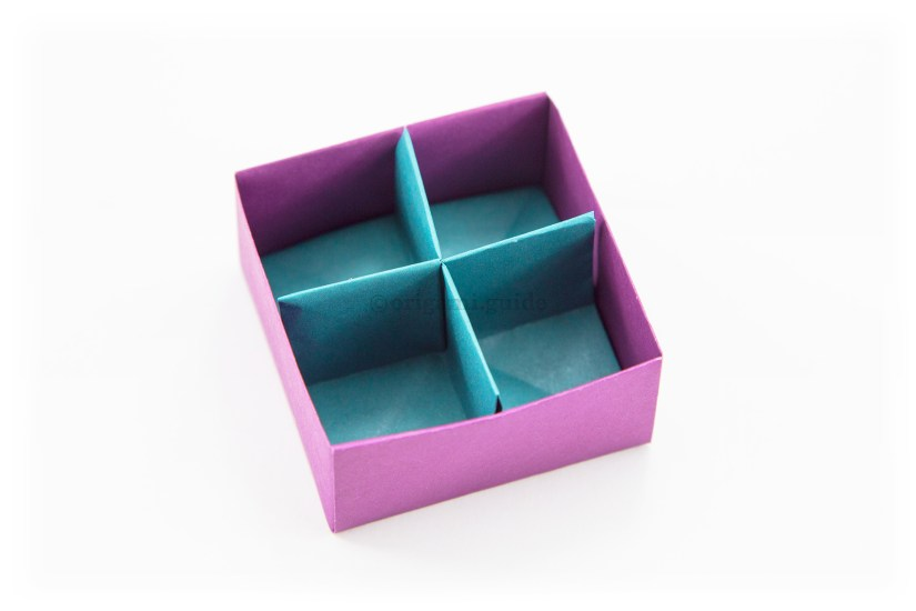 35. Now you place the divider inside your masu box. You have now completed the origami box divider.