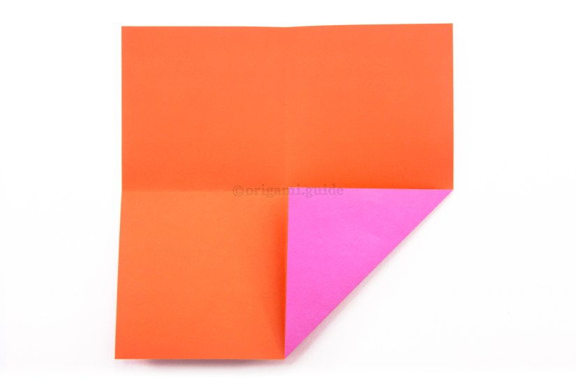 6. Fold the bottom right corner up to the very center of the paper.