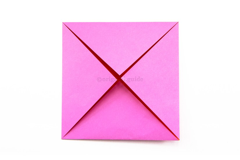 7. Fold the other three corners of the paper to the middle.