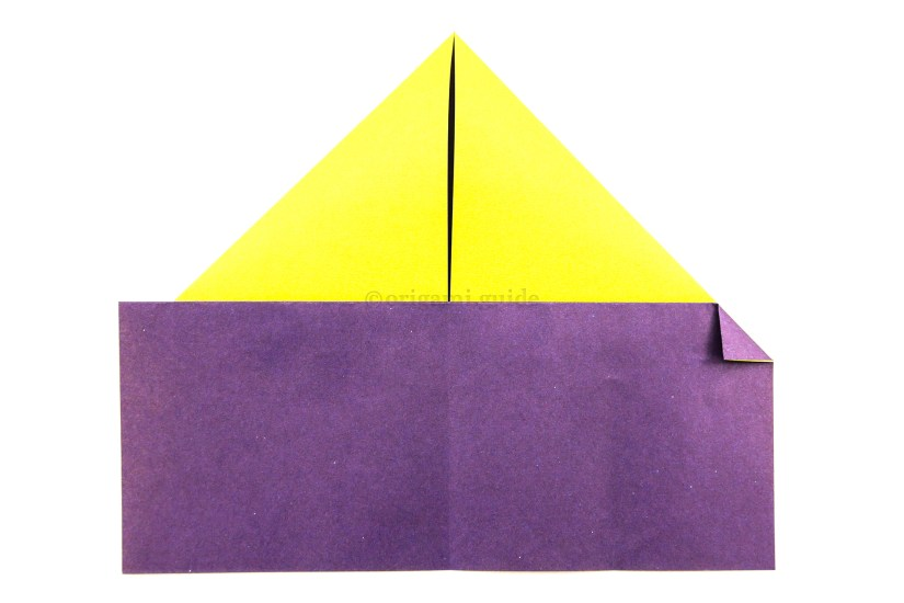 9. Fold the right point of the new edge you created in the last step in diagonally.