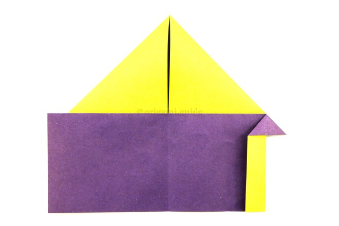 12. Fold the right edge of the lower section to the left, the reversed fold underneath will determine how far the paper can be folded.