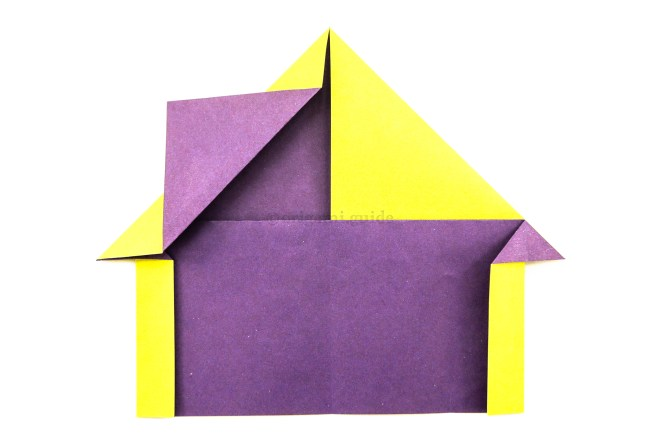 15. Fold the loose flip up diagonally to create a chimney.