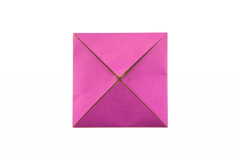 25. Fold the other three corners to the center.