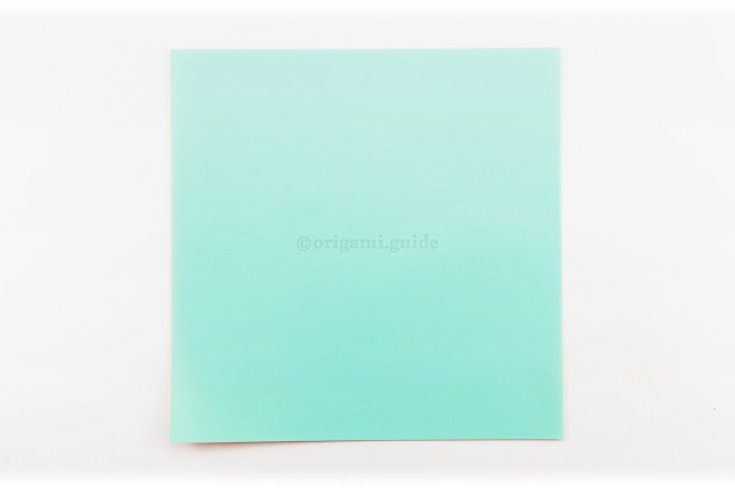 1. This is the front of the origami paper, our pinwheel will end up being this colour.