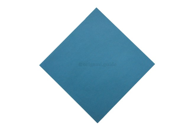 2. Flip the paper over to the back, origami paper is usually white on this side.
