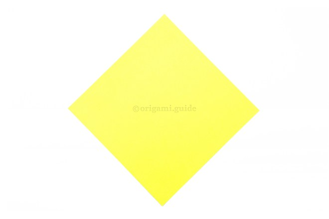 2. This is the back of the origami paper, our boat's sail will be this color.