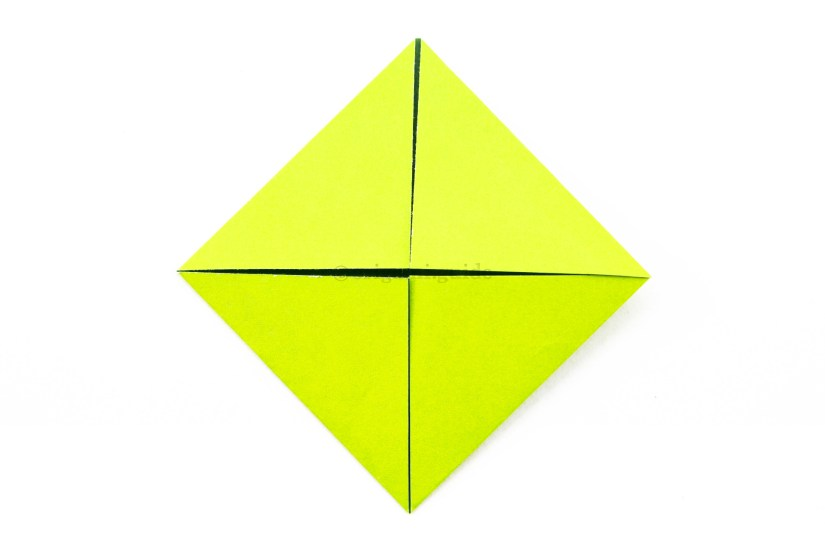 7. Fold the other three corners to the center of the paper.