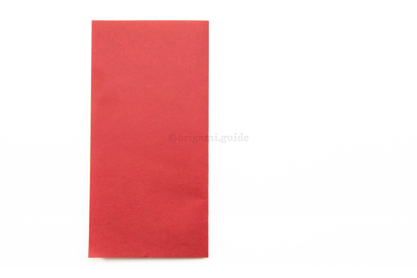 3. Fold the right edge of the paper over to the left.