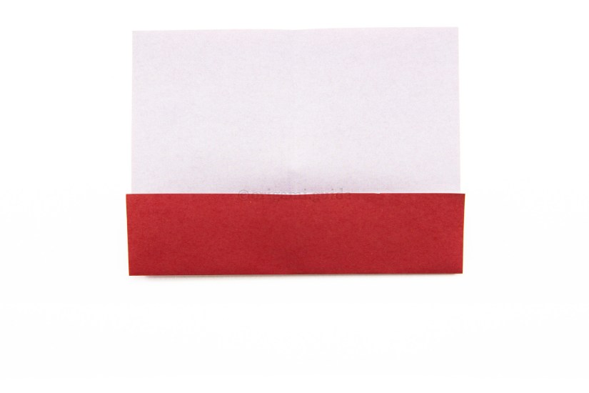 7. Fold the bottom edge of the paper up to the central crease.