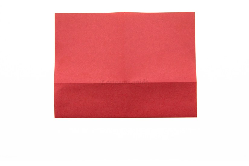 8. Flip the paper over to the other side, from left to right.