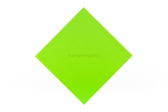 1. This is the front of the paper, our origami bird will end up being predominantly this colour.