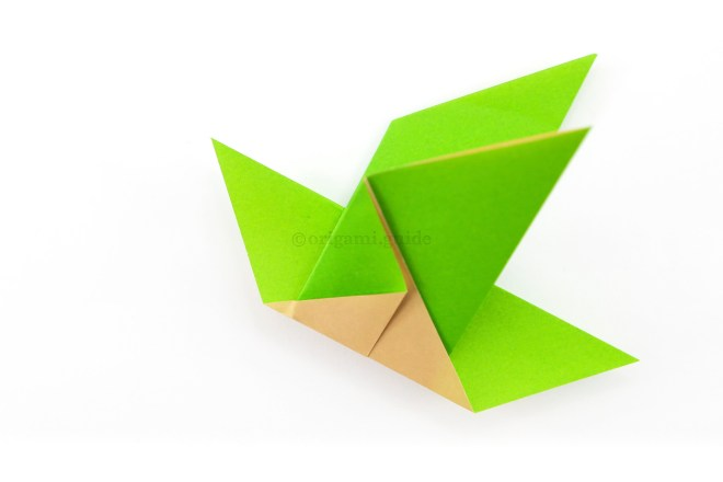 11. Now you can create a beak shape for the origami bird.