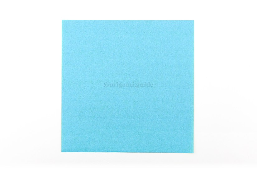 1. Start with a square sheet of origami paper.