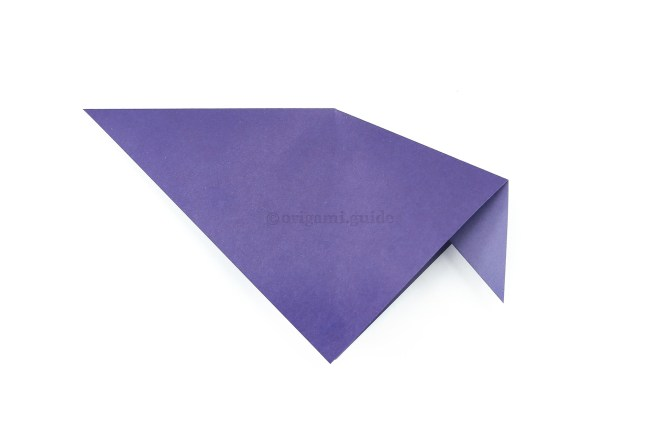 """6. Push the corner """"inside"""" and flatten the paper. The inside reverse fold is complete."""