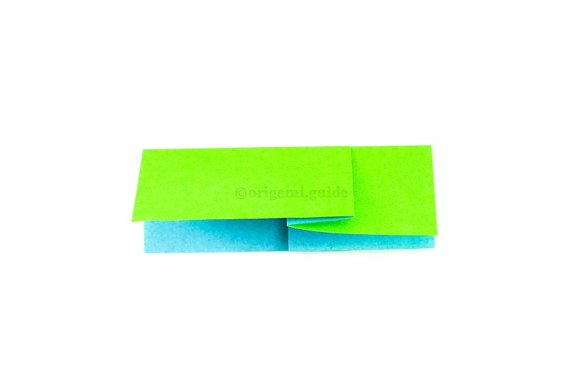 4. To make a crimp fold, simply fold the paper in half from top to bottom.