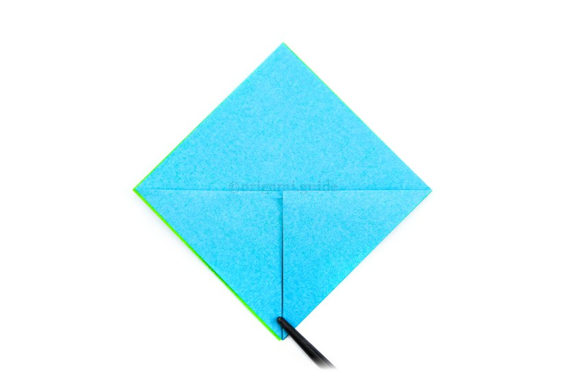 7. Fold the top point of both flaps down to the bottom point.
