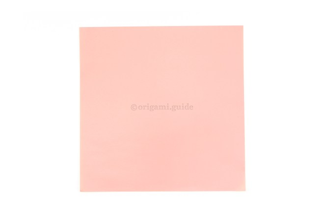 1. This is the front of our origami paper, the main area of the heart will be this color.