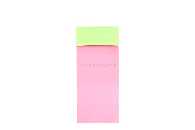 Fold the top edge of the paper down to meet the end of the diagonal creases you made in the previous steps.