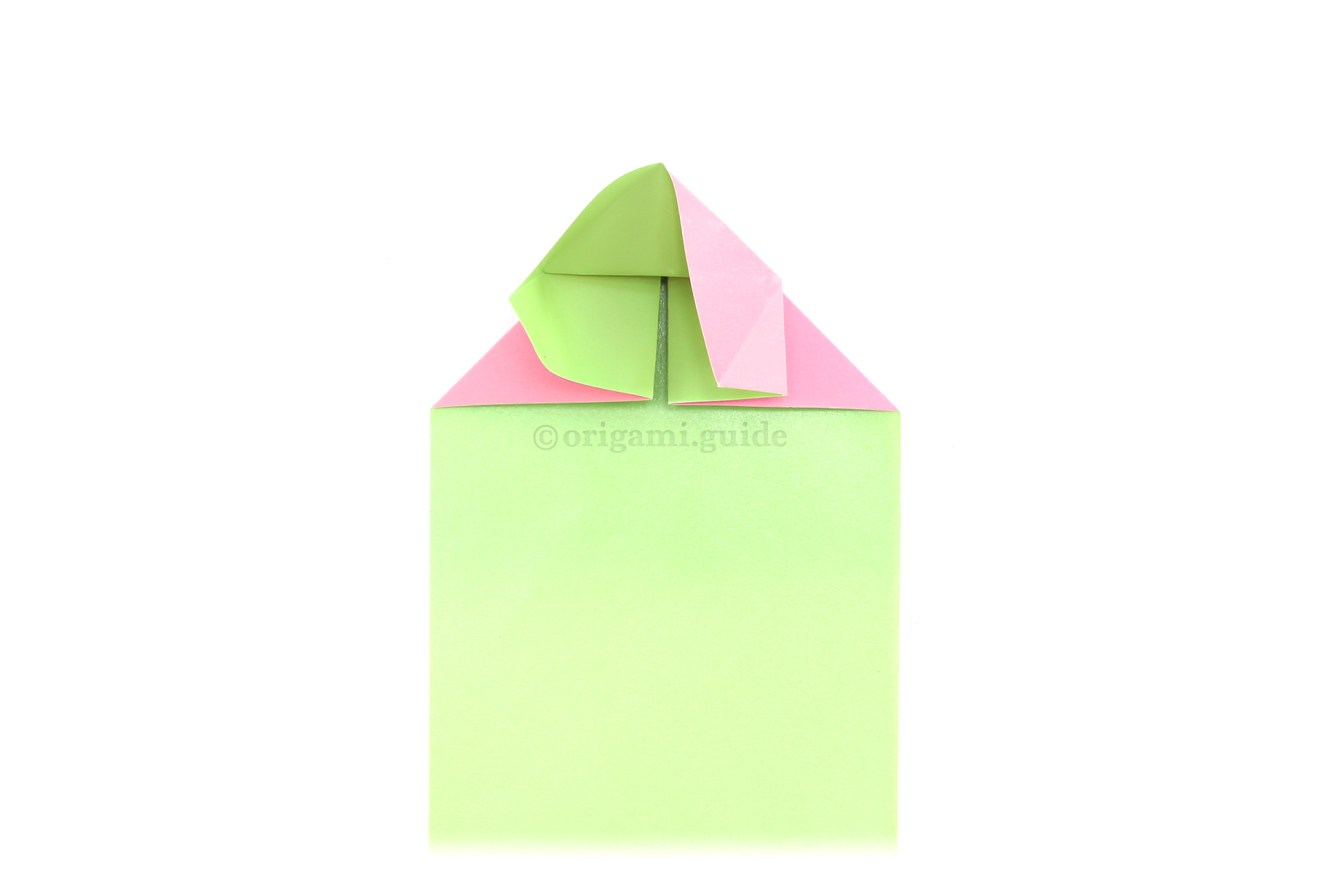 Fold the right point down to the middle whilst keeping the paper in place at the top.