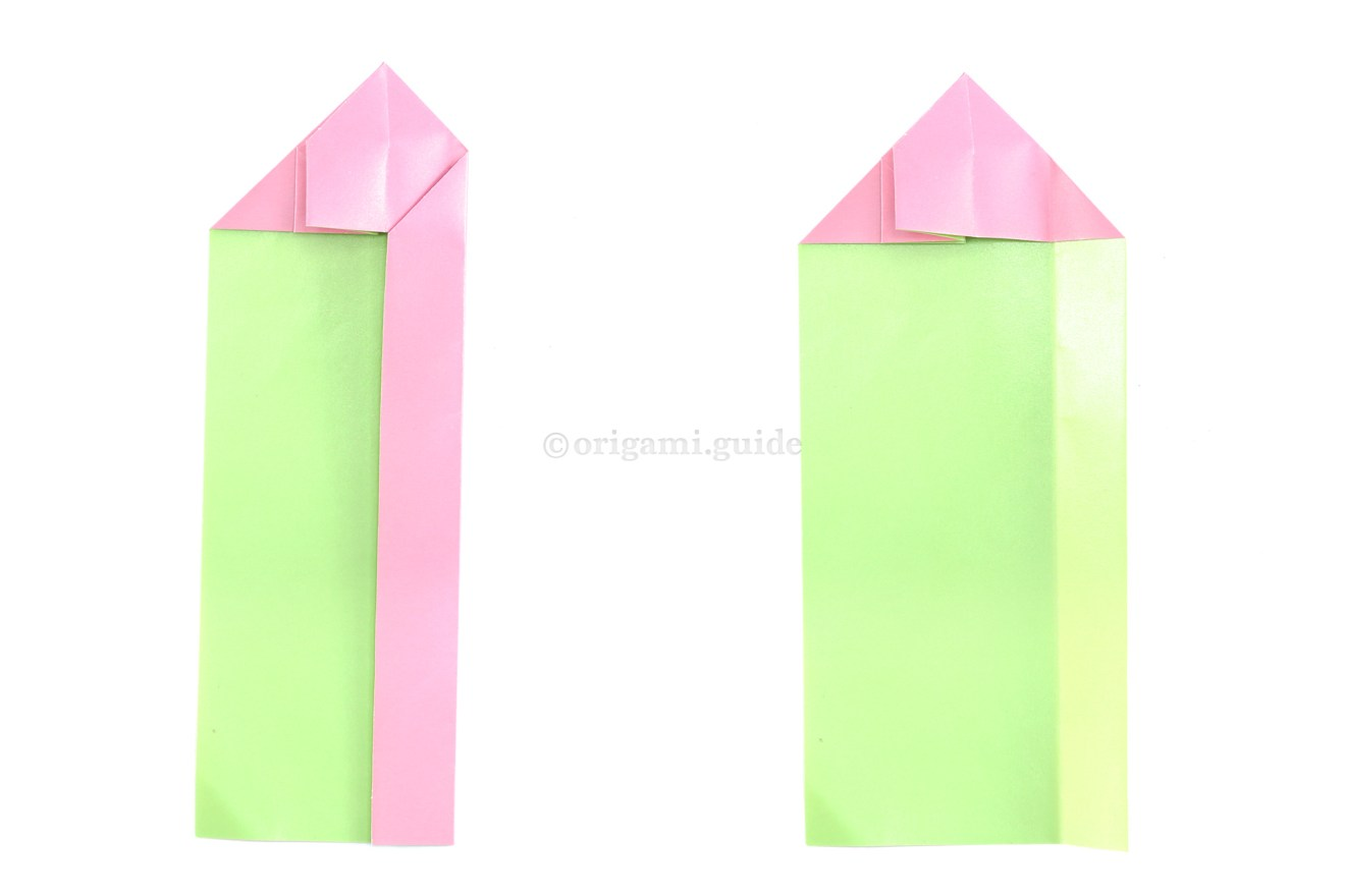 Fold the right edge left to align with the middle. Then unfold.