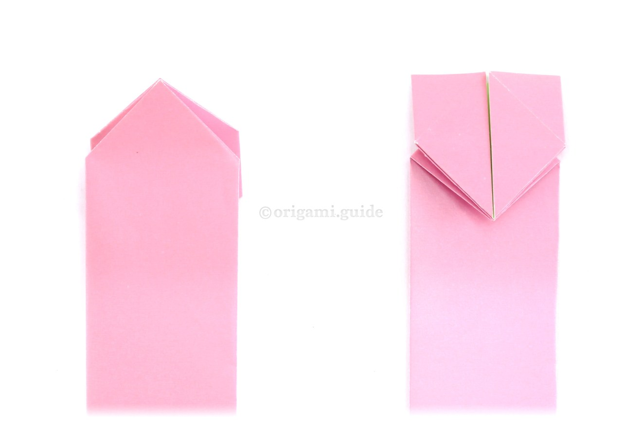 Flip the model over to the other side. Next, fold the top point down.