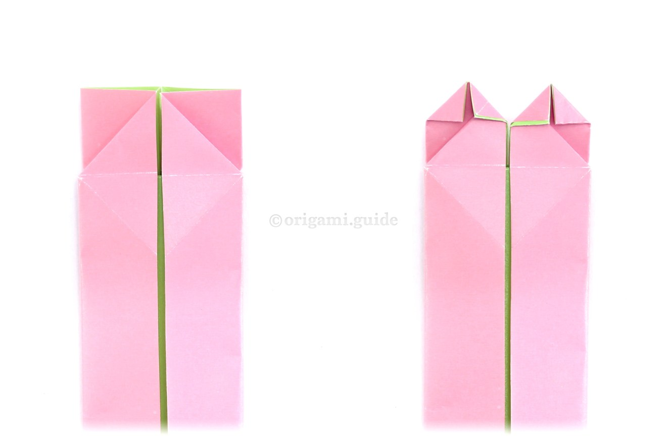Flip the model back over to the other side. Next, shape the top of the heart by folding the top points diagonally down.
