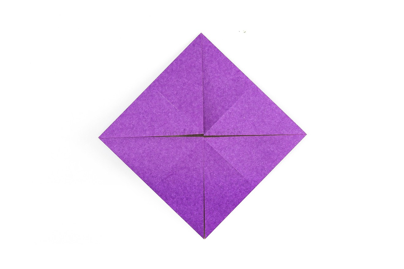 Now fold all of the other corners to the middle point.