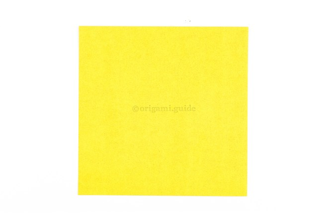 This is the front of our origami paper, our origami fish will end up being this colour.