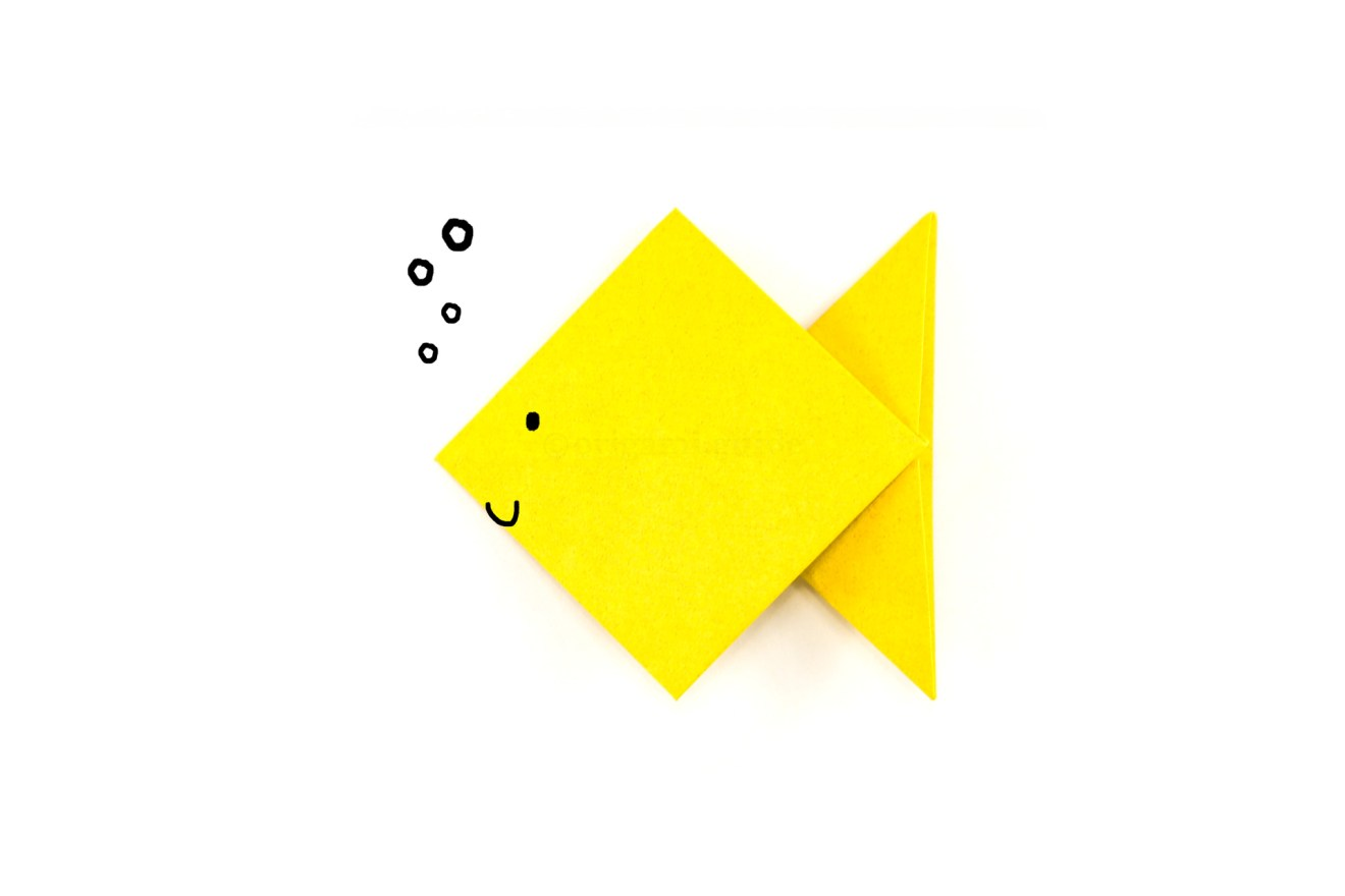 You can draw a face, fins or scales, or maybe even colourful washi tape could be used to decorate your new origami fish friend.