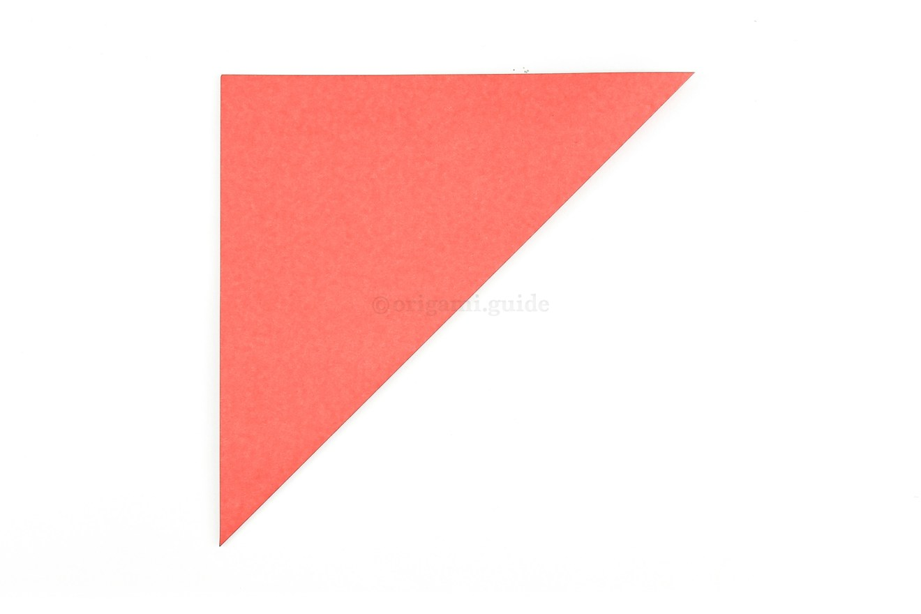 We will start by making a square base. Fold the bottom right corner diagonally up to the top left corner. (skip to page 2, step 14 if you already know the square base)