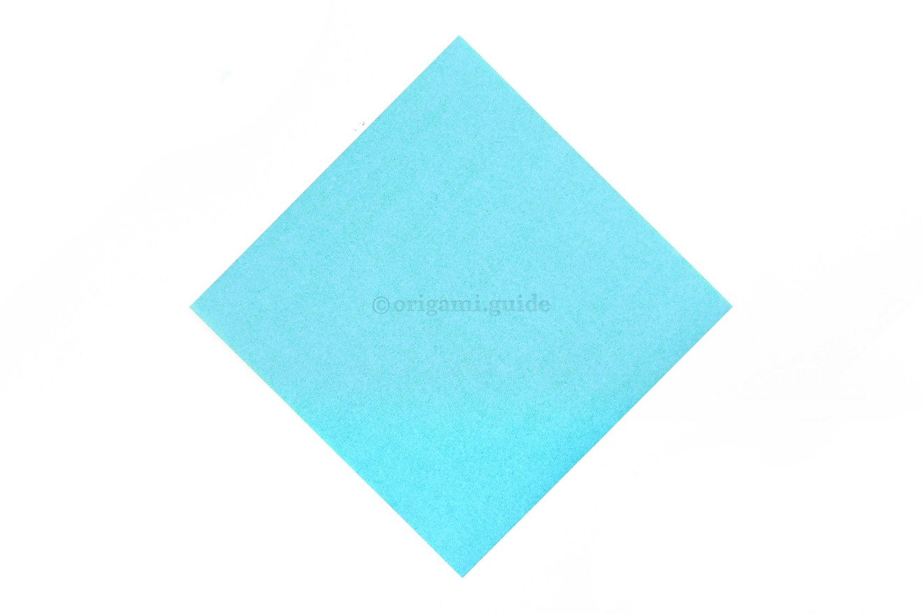 This is the front of our origami paper, our dog face will be this colour.
